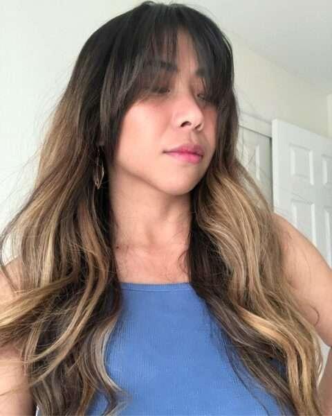 pelo largo a capas con flequillo